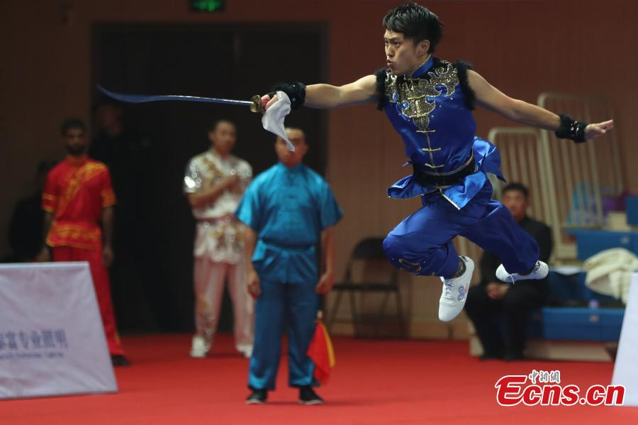 An athlete competes at the first Asian Traditional Wushu (Kungfu) Championship in Nanjing, East China's Jiangsu province on November 29, 2018. The event attracts athletes from 12 countries and regions including China, Brunei, India, Japan, and Kazakhstan to take part in. (Photo: China News Service/ Yang Bo)