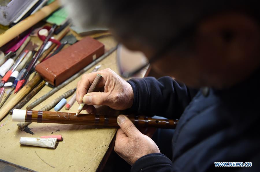 Liu Zesong, inheritor of the Yuping bamboo flute making craft, prepares for carving on a flute in Yuping Dong Autonomous County, southwest China\'s Guizhou Province, Nov. 29, 2018. As a traditional Chinese bamboo instrument, Yuping bamboo flute is famous for its clear tone and delicate carving. Made from local bamboo, the flute goes through dozens of procedures before finished and merges folk cultures of other ethnic groups. It was listed as one of the National Intangible Cultural Heritages in 2006. (Xinhua/Ma Ning)