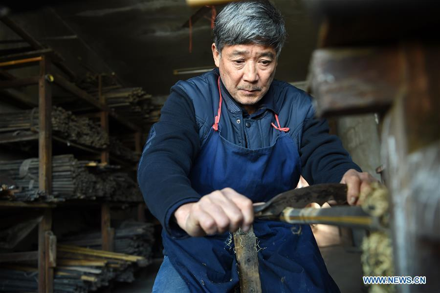 Liu Zesong, inheritor of the Yuping bamboo flute making craft, deals with bamboo materials for making a flute in Yuping Dong Autonomous County, southwest China\'s Guizhou Province, Nov. 29, 2018. As a traditional Chinese bamboo instrument, Yuping bamboo flute is famous for its clear tone and delicate carving. Made from local bamboo, the flute goes through dozens of procedures before finished and merges folk cultures of other ethnic groups. It was listed as one of the National Intangible Cultural Heritages in 2006. (Xinhua/Ma Ning)