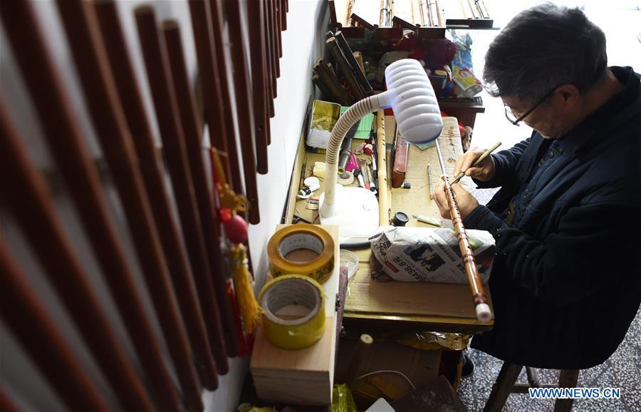Liu Zesong, inheritor of the Yuping bamboo flute making craft, carves on a flute in Yuping Dong Autonomous County, southwest China\'s Guizhou Province, Nov. 29, 2018. As a traditional Chinese bamboo instrument, Yuping bamboo flute is famous for its clear tone and delicate carving. Made from local bamboo, the flute goes through dozens of procedures before finished and merges folk cultures of other ethnic groups. It was listed as one of the National Intangible Cultural Heritages in 2006. (Xinhua/Ma Ning)