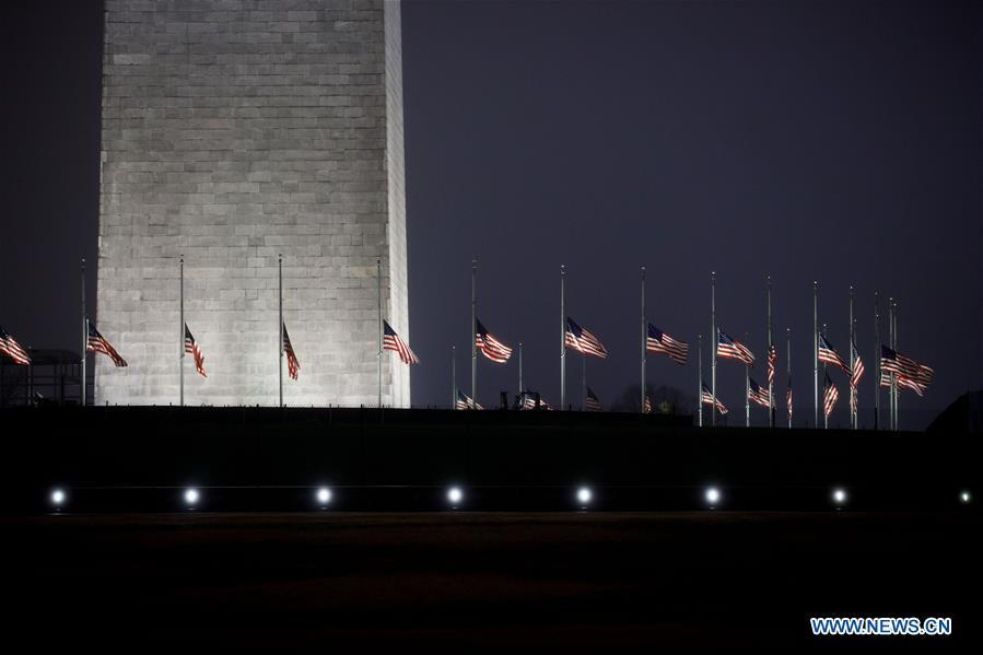 U.S. national flags are seen at half-staff at the Washington Monument in tribute to former U.S. President George H. W. Bush in Washington D.C. Dec. 1, 2018. (Xinhua/Ting Shen)