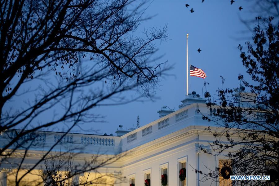 The U.S. national flag flies at half-staff at the White House in tribute to former U.S. President George H. W. Bush in Washington D.C. Dec. 1, 2018. (Xinhua/Ting Shen)