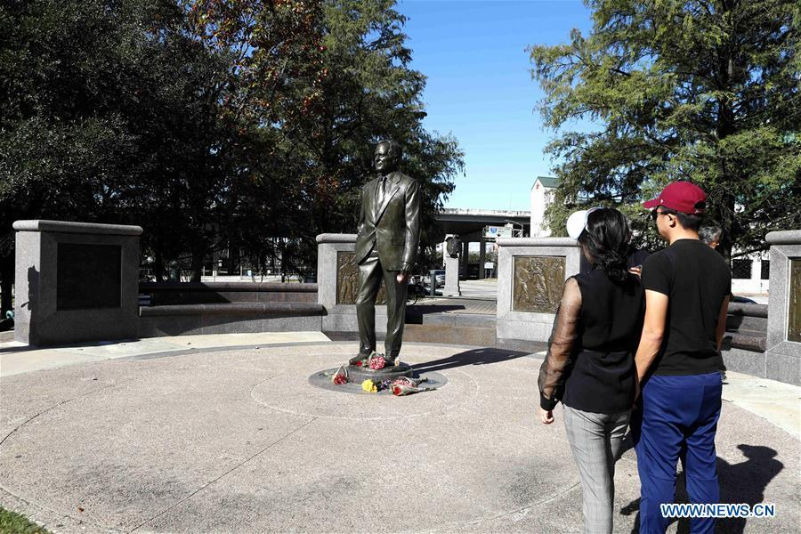 People stand in front of a statue of former U.S. President George H.W. Bush in Houston, Texas, the United States, on Dec. 1, 2018. George H.W. Bush, the 41st president of the United States, has died Friday at the age of 94, according to a statement from his office. (Xinhua/Steven Song)