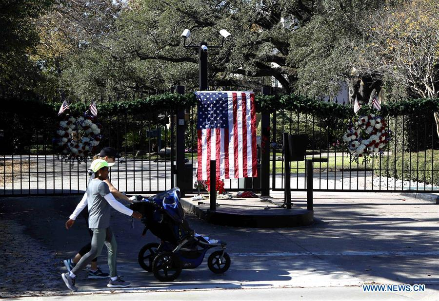 People walk past the gate of the residence of former U.S. President George H.W. Bush in Houston, Texas, the United States, on Dec. 1, 2018. George H.W. Bush, the 41st president of the United States, has died Friday at the age of 94, according to a statement from his office. (Xinhua/Steven Song)