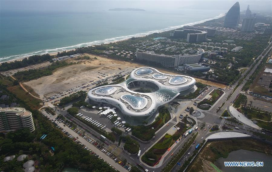 Photo taken on Dec. 1, 2018 by a drone shows an international duty free mall in Sanya, south China\'s Hainan Province. Effective on Saturday, China\'s Hainan Province raised its annual tax-free shopping quota to 30,000 yuan (about 4,300 U.S. dollars) per year from the current 16,000 yuan for travelers, without limit on the number of purchases, according to a joint statement from the Ministry of Finance (MOF) and China\'s customs and taxation authorities. (Xinhua/Yang Gaunyu)