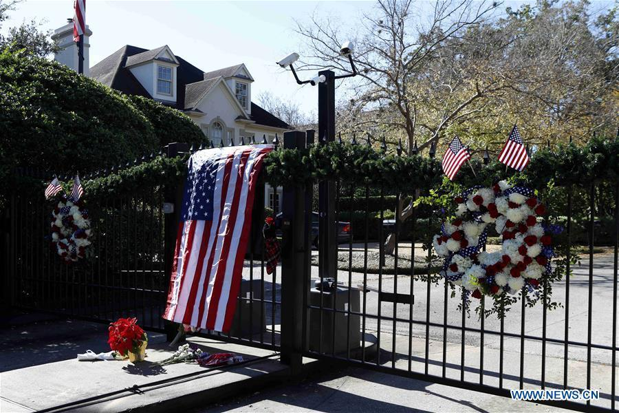 Flowers are seen presented at the gate of the residence of former U.S. President George H.W. Bush to commemorate his death in Houston, Texas, the United States, on Dec. 1, 2018. George H.W. Bush, the 41st president of the United States, has died Friday at the age of 94, according to a statement from his office. (Xinhua/Steven Song)