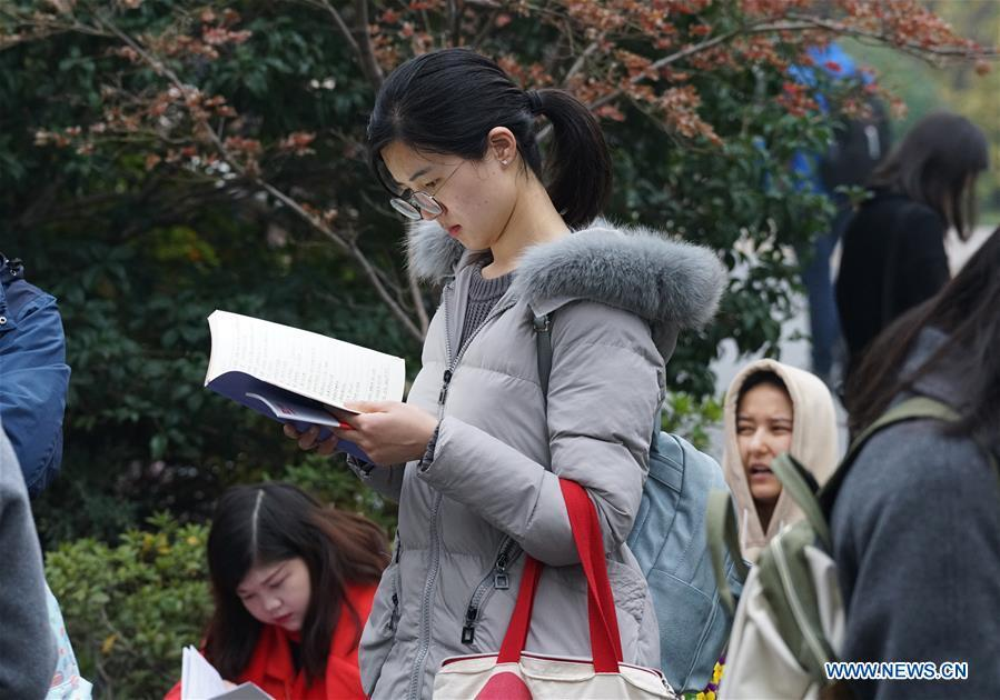 Candidates review before taking the national civil servant exam at Nanjing Forestry University in Nanjing, capital of east China\'s Jiangsu Province, Dec. 2, 2018. The written exam of the national civil servant exam was held on Sunday across the country. (Xinhua/Sun Can)