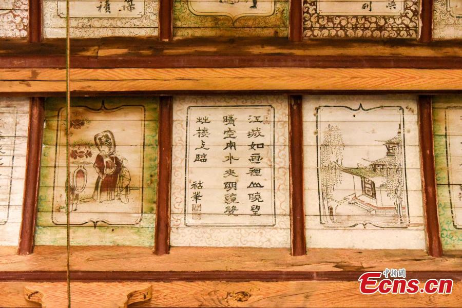 Ancient paintings in an ancestral hall in Sanxi village, Heyuan town, Suichuan county, Ji\'an city, Jiangxi province, on Dec 1, 2018. There is an ancestral hall in Sanxi village, Ji\'an city of Jiangxi province, where exquisite ancient calligraphy and paintings have remained preserved. The hall was built in 1826, during the reign of Emperor Daoguang in the Qing Dynasty (1644-1911). There are more than 120 calligraphy pieces and paintings in the meticulous gongbi style on the caisson and ceiling of the ancestral hall. These paintings feature figures, landscapes, flowers, birds, insects and fish, as well as folk tales and illustrated poems.(Photo: China News Service/ Xiao Yuanpan)