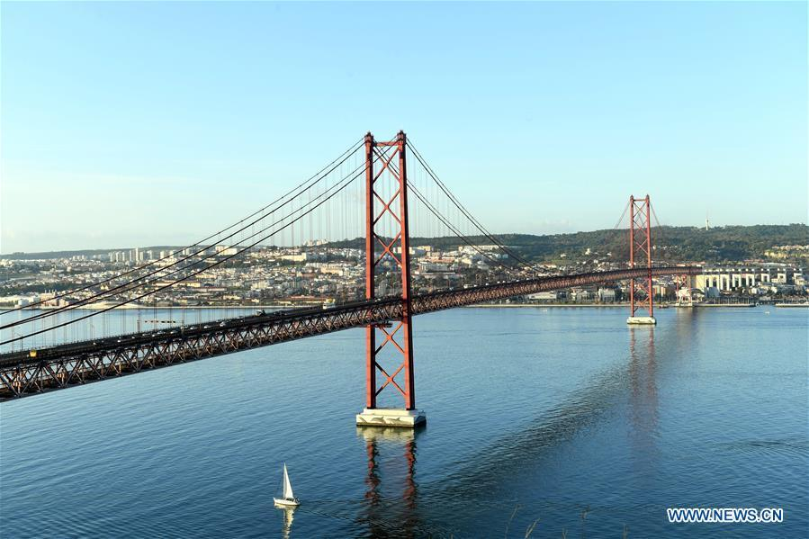 <?php echo strip_tags(addslashes(Photo taken on Nov. 30, 2018 shows the 25th of April Bridge (25 de Abril Bridge) over the Tagus river in Lisbon, Portugal. (Xinhua/Zhang Liyun))) ?>