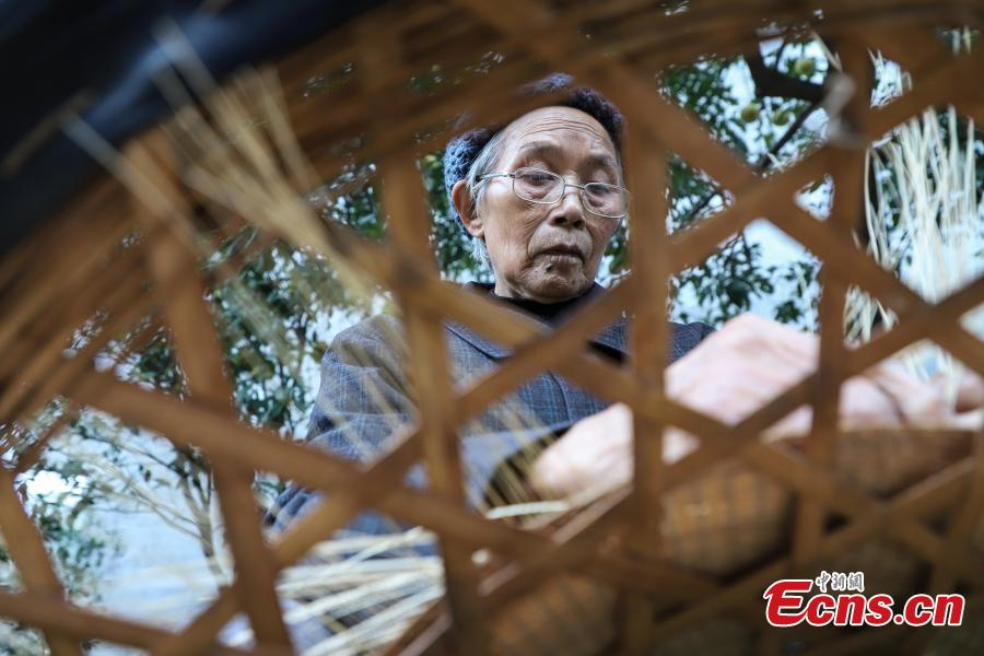 Song Erfeng knit a hat with bamboo filaments as thin as hair in a village in Tangtou town, Southwest China\'s Guizhou province.  (Photo: China News Service/ Qu Honglun)
