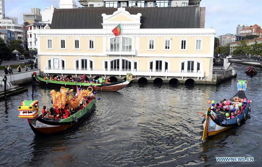 <?php echo strip_tags(addslashes(Photo taken on June 16, 2018 shows dragon boats sailing on a river in Aveiro, Portugal. (Xinhua/Zhang Liyun))) ?>