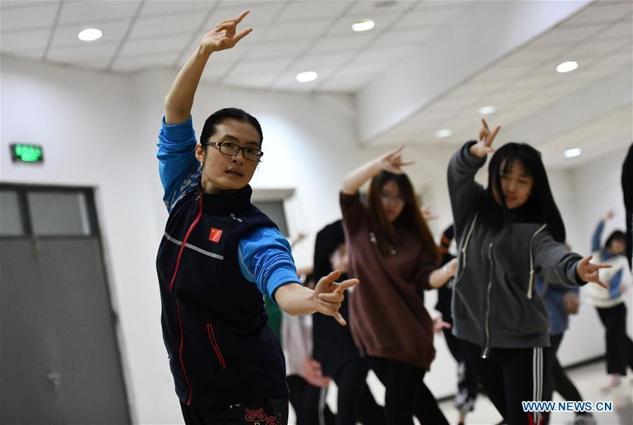 Huo Jinghong, the 5th generation descendant of Huo Yuanjia, a Chinese martial arts master, teaches martial arts at Tianjin University of Commerce in Tianjin, north China, Nov. 26, 2018. As the descendant of Huo Yuanjia, one of China\'s most revered martial arts masters, Huo Jinghong, 41, started practicing martial arts at the age of 5. After her graduation from the Wushu School of Beijing Sport University in major of Wushu Routine, Huo started her career as a gym teacher of Tianjin University of Commerce in the year of 2000. As a gym teacher, Huo teaches martial arts for the university team and offers classes on health Qigong, a new form selected from different versions of traditional Qigong for modern fitness, in the university. Later in 2015, Huo became the inheritor of Huo-style boxing, which was listed as an intangible cultural heritage in Tianjin, and since then, she has devoted herself to the inheritance and development of the martial arts handed down from the older generation of Huo\'s family. She hoped that the Huo-style boxing would help people understand more about the Chinese martial arts. Huo Yuanjia was born in Tianjin in 1868. He founded the Chin Woo Athletic Association in 1910 in Shanghai and advocated the spirit of \