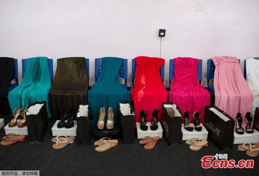Gowns and shoes are laid out for female inmates who are competing in the 13th annual Miss Talavera Bruce beauty pageant, the namesake of the female prison in western Rio de Janeiro, Brazil, Tuesday, Dec. 4, 2018. For a day, about a dozen women serving time at the penitentiary swap their uniforms for gowns.(Photo/Agencies)