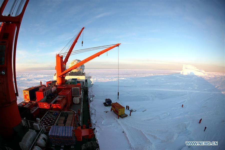 A crane unloads a container of supplies from China\'s research icebreaker Xuelong in Antarctica, Dec. 2, 2018. China\'s research icebreaker Xuelong, also known as the Snow Dragon, is now 44 kilometers away from the Zhongshan station. Unloading operations have been carried out after the routes were determined. (Xinhua/Liu Shiping)