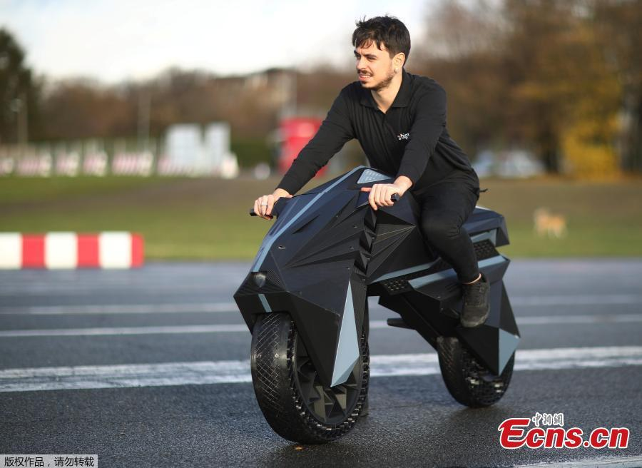 Designer Marco Mattia Cristofori of the German 3D printer manufacturer BigRep, stands with his nearly completely 3D printed e-motorcycle NERA, at the airfield Tempelhof in Berlin, Germany, December 3, 2018.(Photo/Agencies)