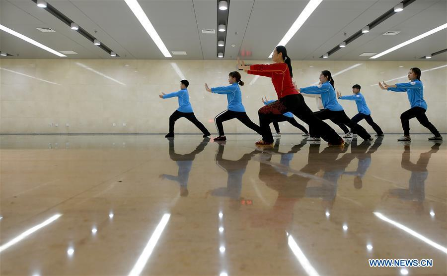 Huo Jinghong, the 5th generation descendant of Huo Yuanjia, a Chinese martial arts master, teaches martial arts at Tianjin University of Commerce in Tianjin, north China, Nov. 28, 2018. As the descendant of Huo Yuanjia, one of China\'s most revered martial arts masters, Huo Jinghong, 41, started practicing martial arts at the age of 5. After her graduation from the Wushu School of Beijing Sport University in major of Wushu Routine, Huo started her career as a gym teacher of Tianjin University of Commerce in the year of 2000. As a gym teacher, Huo teaches martial arts for the university team and offers classes on health Qigong, a new form selected from different versions of traditional Qigong for modern fitness, in the university. Later in 2015, Huo became the inheritor of Huo-style boxing, which was listed as an intangible cultural heritage in Tianjin, and since then, she has devoted herself to the inheritance and development of the martial arts handed down from the older generation of Huo\'s family. She hoped that the Huo-style boxing would help people understand more about the Chinese martial arts. Huo Yuanjia was born in Tianjin in 1868. He founded the Chin Woo Athletic Association in 1910 in Shanghai and advocated the spirit of \