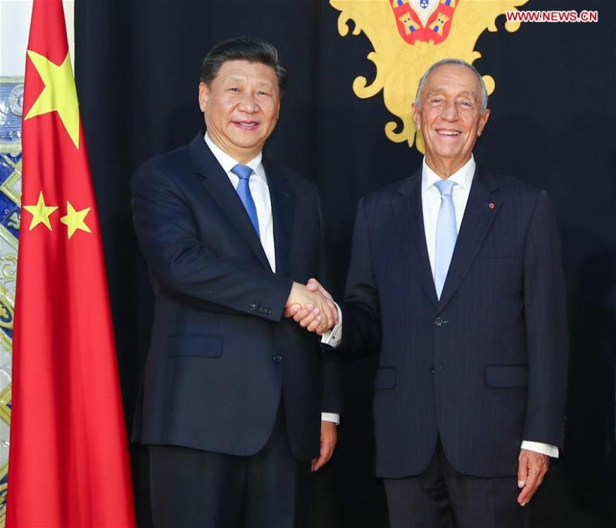Chinese President Xi Jinping (L) shakes hands with Portuguese President Marcelo Rebelo de Sousa in Lisbon, Portugal, Dec. 4, 2018. President Xi Jinping held talks with President Marcelo Rebelo de Sousa on Tuesday. (Xinhua/Xie Huanchi)