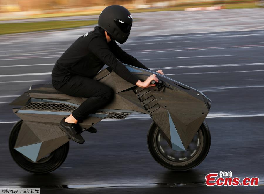 Designer Marco Mattia Cristofori of the German 3D printer manufacturer BigRep, rides his nearly completely 3D printed e-motorcycle NERA, at the airfield Tempelhof in Berlin, Germany, December 3, 2018.(Photo/Agencies)