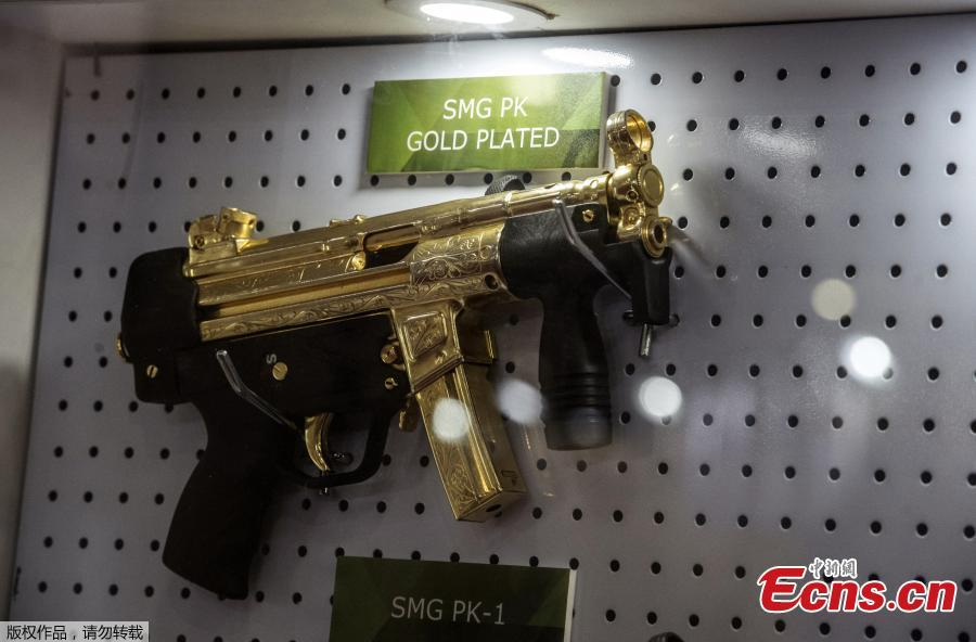 A gold plated weapon is displayed at the Pakistani stand during Egypt\'s first Service Defence Exhibition in Cairo on December 3, 2018, at the International Exhibition Center. (Photo/Agencies)