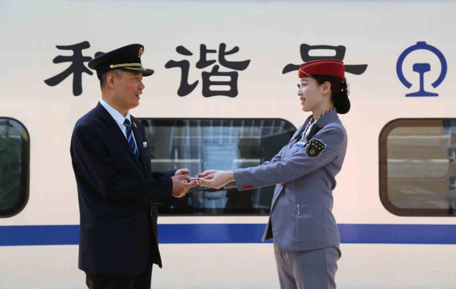 Sun Mingjin has applied for a high-speed train key, even though he didn\'t get a chance to work on these trains. (Photo by Qu Xiaoxi for chinadaily.com.cn)