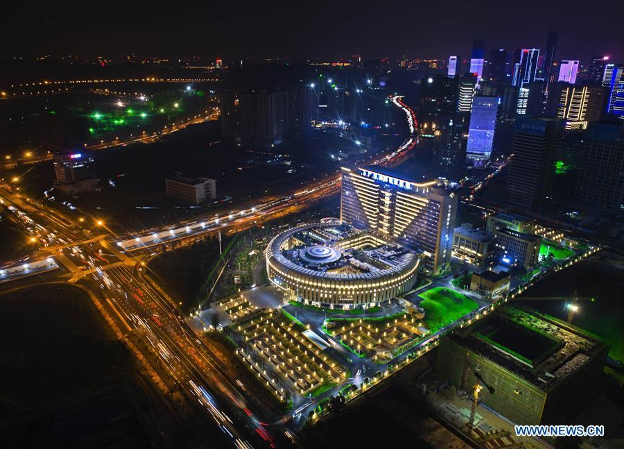 Aerial photo taken on Sept. 11, 2018 shows the night scenery of Guangxi International Zhuang Medicine Hospital in Nanning, capital city of south China\'s Guangxi Zhuang Autonomous Region. This year marks the 60th anniversary of the establishment of the Guangxi Zhuang Autonomous Region. (Xinhua/Zhou Hua)