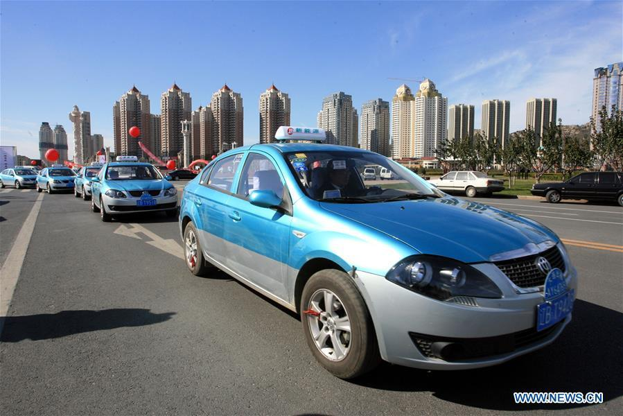 The first batch of new energy taxis are put into operation in Dalian, northeast China\'s Liaoning Province, Oct. 26, 2010. China has been delivering on its commitment to the international community on climate change by continuously shifting to a more green economy over the past years. New energy-rich regions like Inner Mongolia and Ningxia are sending more electricity generated from clean energy to the country\'s bustling east to help reduce the country\'s heavy reliance on coal in the fight against pollution and coping with climate change. China is also a leader in new energy vehicles (NEVs), with many regions across the country moving to replace their traditional gasoline-powered buses and taxis with green-energy vehicles. The country has been the world\'s largest NEV market for three consecutive years, with some 777,000 NEVs sold in 2017 alone. Sales in the first 10 months of this year jumped 75.6 percent year on year to 860,000 units. Thanks to increased investment in green energy, China\'s carbon intensity, or the amount of carbon dioxide emissions per unit of GDP, in 2017 had declined by 46 percent from 2005 levels, meeting the target ahead of schedule of a 40-45 percent drop by 2020, according to the Chinese Ministry of Ecology and Environment. (Xinhua/Zhang Chunlei)