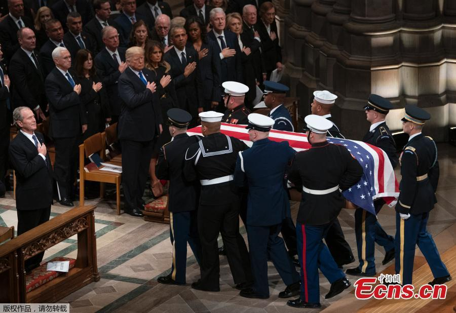 The flag-draped casket of former President George H.W. Bush is carried by a joint services military honor guard during a departure ceremony at Andrews Air Force Base, Md., Wednesday, Nov. 5, 2018.(Photo/Agencies)