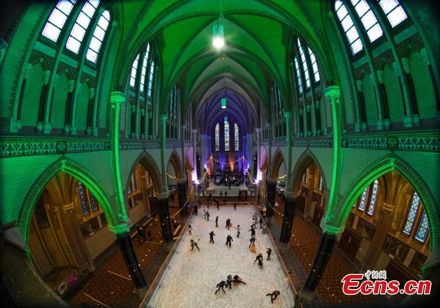 People skate on a temporary ice rink in the Gouwe Kerk church, a Gothic Revival church built between 1902 and 1904, in the center of Gouda, central Netherlands, Wednesday, Dec. 5, 2018. The ice rink will remain in the church till Dec. 16, and from Dec. 19, people can enjoy skating on the rink in front of the historic town hall of Gouda. (Photo/Agencies)