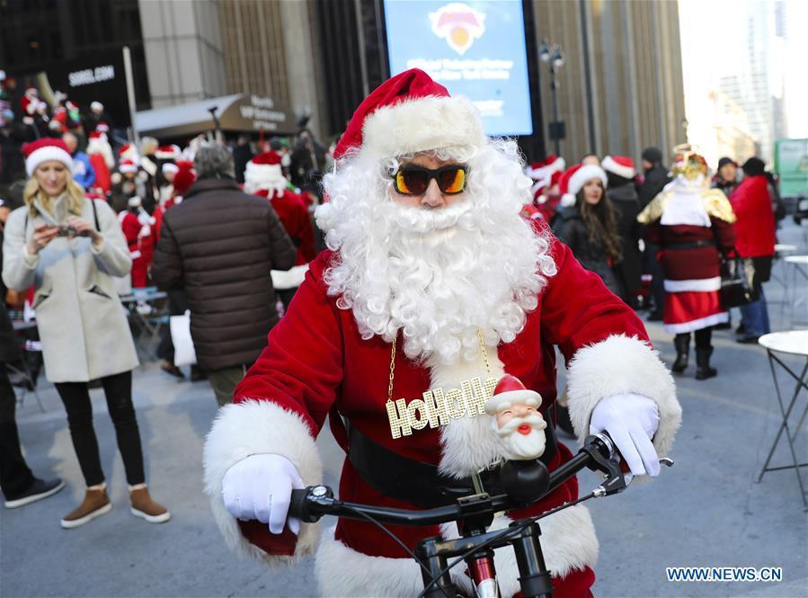 A reveler dressed as Santa Claus takes part in the 2018 SantaCon in New York, the United States, Dec. 8, 2018. Dressed as Santa Claus or in festive costumes, hundreds of People participated in the 2018 SantaCon on Saturday, enjoying the Christmas atmosphere and raising money for charity. (Xinhua/Wang Ying)