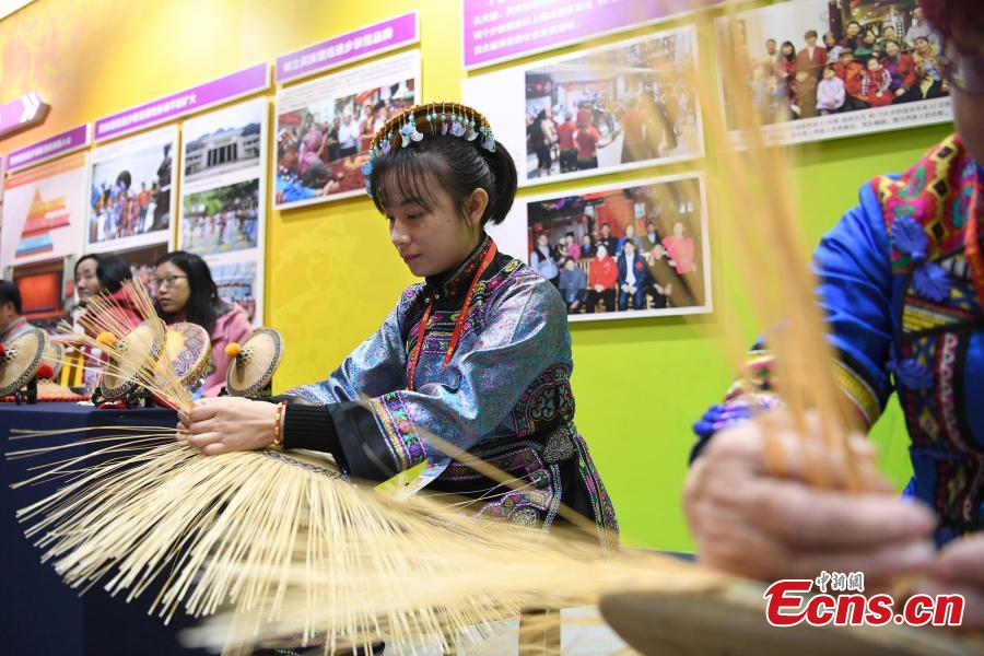 An exhibition to mark the 60th anniversary of the establishment of the Guangxi Zhuang Autonomous Region opens in the region's capital Nanning City, Dec. 10, 2018. Established in 1958 as an autonomous region, Guangxi has a population of 56 million, including more than 20 million who identify as ethnic minorities. It tops in China's provincial-level regions in minority populations. (Photo: China News Service/Hou Yu)