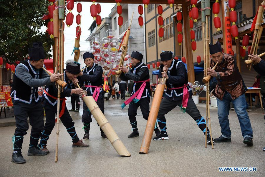 People of Dong ethnic group play Lusheng to welcome guests at Jiasuo Dong Village of Zhongchao Township in Liping County, southwest China\'s Guizhou Province, Dec. 9, 2018. Dong people celebrated the new year through various activities on Dec. 7-9. (Xinhua/Yang Wenbin)