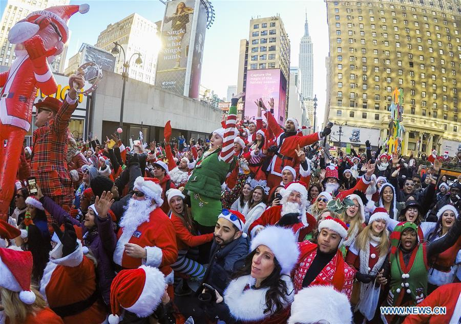 Revelers take part in the 2018 SantaCon in New York, the United States, Dec. 8, 2018. Dressed as Santa Claus or in festive costumes, hundreds of People participated in the 2018 SantaCon on Saturday, enjoying the Christmas atmosphere and raising money for charity. (Xinhua/Wang Ying)