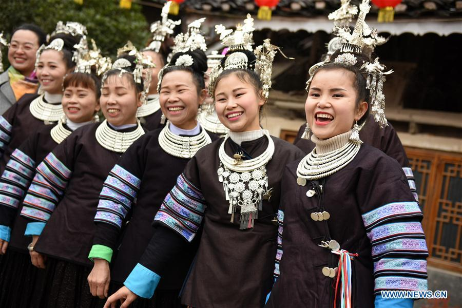 Women dressed in festive costumes attend an activity to celebrate the new year of Dong ethnic group at Jiasuo Dong Village of Zhongchao Township in Liping County, southwest China\'s Guizhou Province, Dec. 9, 2018. Dong people celebrated the new year through various activities on Dec. 7-9. (Xinhua/Yang Wenbin)