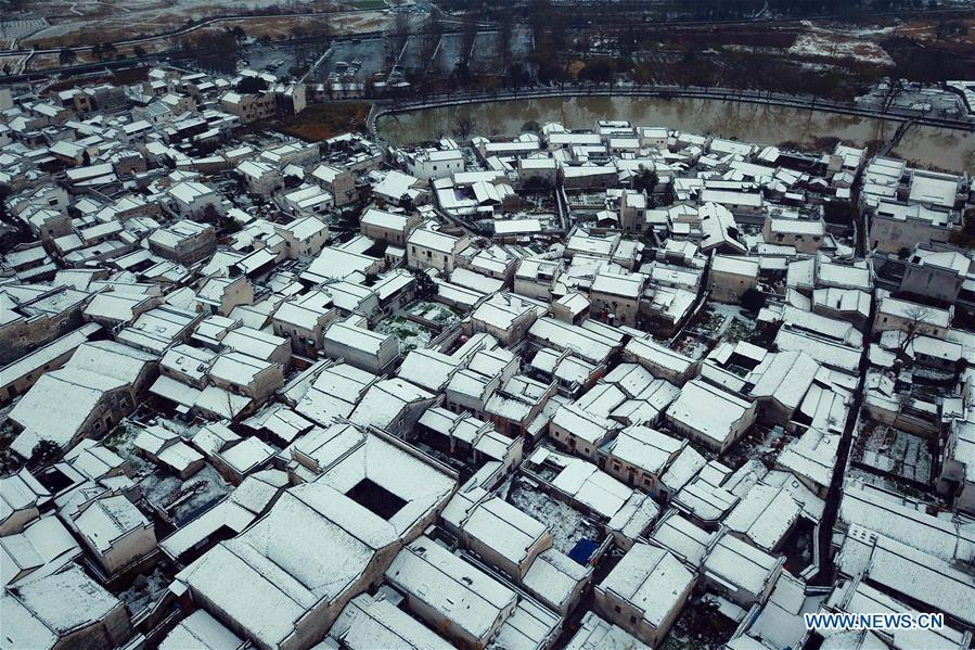 Aerial photo taken on Dec. 9, 2018 shows the snow scenery of Hongcun Village in Yixian County, east China\'s Anhui Province. The cold wave brought snowfall to the village in recent days. (Xinhua/Shi Yalei)
