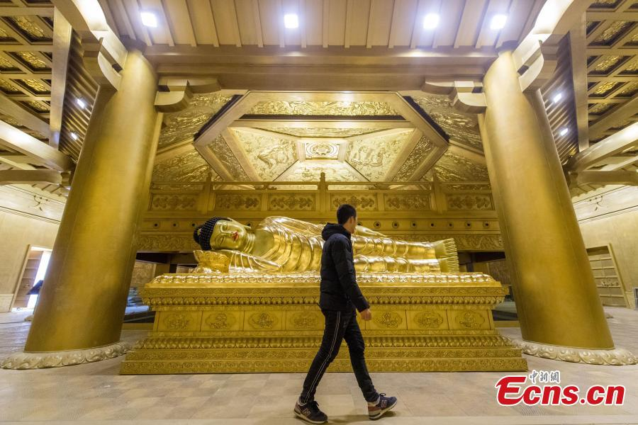This photo shows the Buddha lying at the palace in Taiyuan Longquan Temple, Shanxi Province, on December 7, 2018. The project of restoring several historic buildings at Taiyuan Longquan Temple to preserve original Tang Dynasy (AD 618-907) architecture is ongoing. (Photo: China News Service/ Wei Liang)