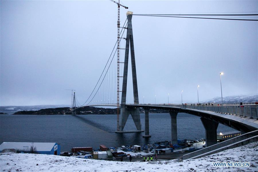 Photo taken on Dec. 9, 2018 shows the Halogaland Bridge near Norway\'s northern port city of Narvik. A ceremony was held Sunday to officially open Norway\'s second largest bridge that has been built by a Chinese company and its partners some 220 km inside the Arctic Circle. With a total length of 1,533 meters and a free span of 1,145 meters, the Halogaland Bridge near Norway\'s northern port city of Narvik is the longest suspension bridge within the Arctic Circle. (Xinhua/Liang Youchang)