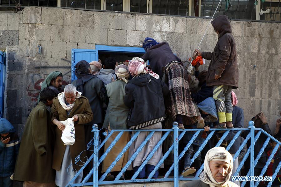 Yemeni people gather at a charity center to receive food aid in Sanaa, Yemen, on Dec. 9, 2018. An estimated 85,000 children under the age of five may have died from extreme hunger between April 2015 and October 2018, according to the latest data released by Save the Children, an international organization for children\'s rights. (Xinhua/Mohammed Mohammed)