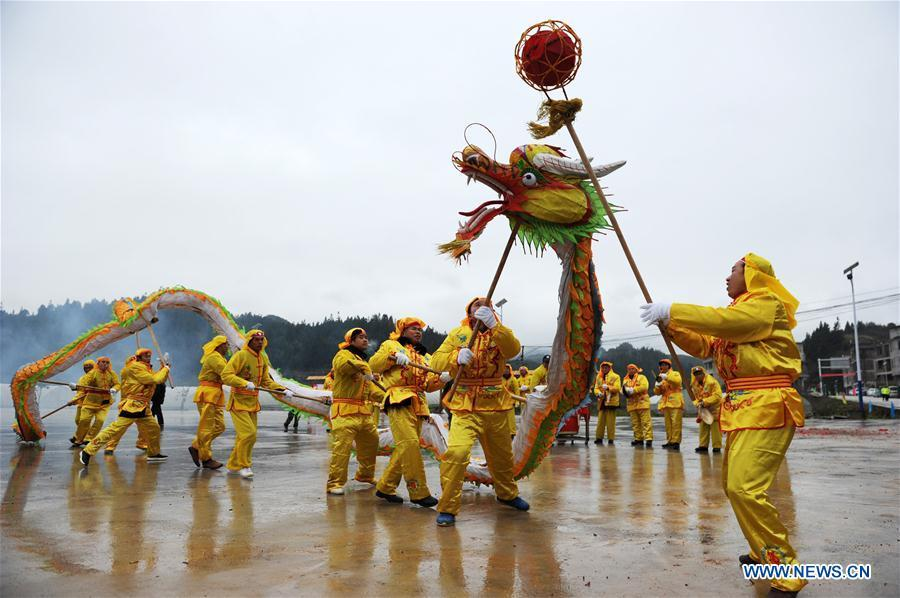 People of Dong ethnic group perform dragon dance at Jiasuo Dong Village of Zhongchao Township in Liping County, southwest China\'s Guizhou Province, Dec. 9, 2018. Dong people celebrated the new year through various activities on Dec. 7-9. (Xinhua/Yang Wenbin)