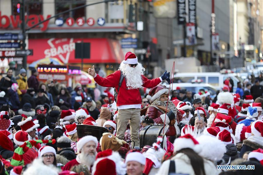 Revelers dressed as Santa Claus take part in the 2018 SantaCon in New York, the United States, Dec. 8, 2018. Dressed as Santa Claus or in festive costumes, hundreds of People participated in the 2018 SantaCon on Saturday, enjoying the Christmas atmosphere and raising money for charity. (Xinhua/Wang Ying)