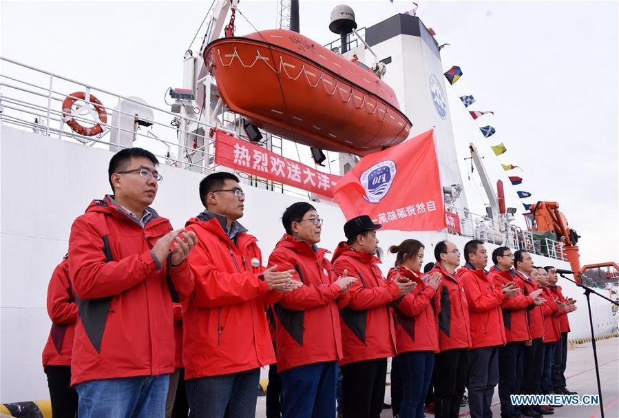 Research team members are seen off by relatives and friends as they depart for the expedition mission on research vessel Dayang Yihao (Ocean No. 1) in Qingdao, east China\'s Shandong Province, Dec. 10, 2018. The vessel departed for a new 230-day scientific ocean expedition. (Xinhua/Li Ziheng)