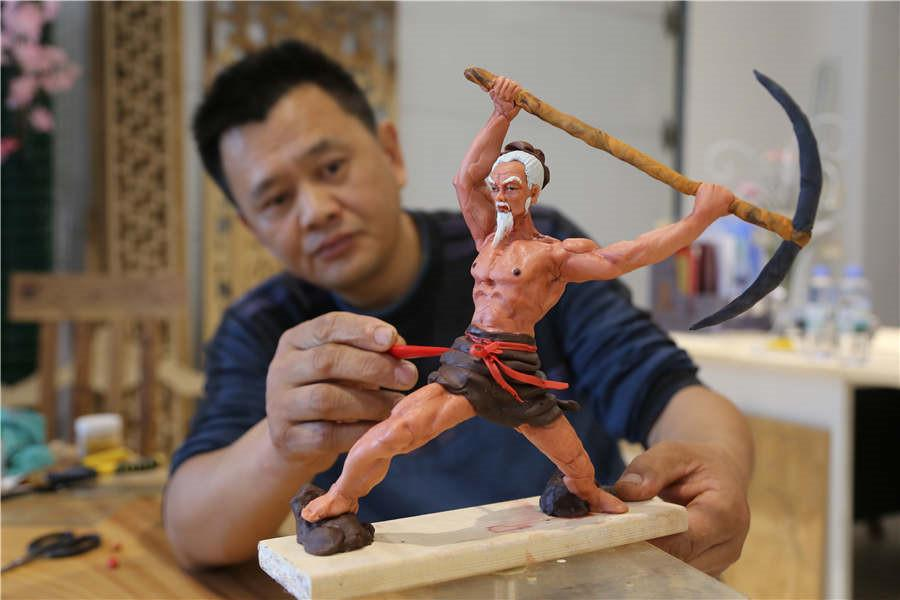 Gao Shan, 43, has been making dough figurines for more than 10 years in Jiyuan city, Central China\'s Henan province.  (Photo by Li Hao/for chinadaily.com.cn)   Gao Shan, 43, has been making dough figurines for more than 10 years in Jiyuan city, Central China\'s Henan province.  The traditional craft dates back to the late Yuan Dynasty (1271-1368) and is listed as a provincial intangible cultural heritage. Folk artists make the figures by hand, using wheat flour and glutinous rice flour as raw materials.  Gao learned the traditional skill from his grandfather in childhood. He said \