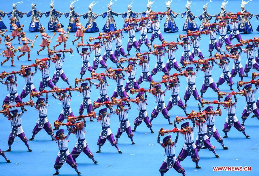 Dancers perform in a grand gathering held to celebrate the 60th anniversary of the founding of south China\'s Guangxi Zhuang Autonomous Region in Nanning, capital of Guangxi, Dec. 10, 2018. (Xinhua/Shen Hong)