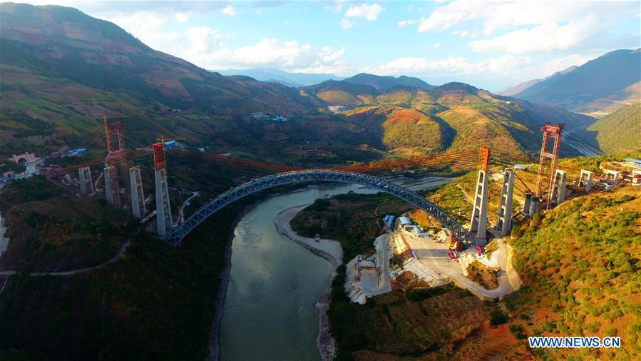 Aerial photo taken on Dec. 9, 2018 shows the railway arch bridge across the Nujiang River in southwest China\'s Yunnan Province. With a grand arch bridge erected on Monday morning, Chinese constructors have built the longest-spanning railway arch bridge with a single span of 490 meters. The bridge is a key project of the 220-km-long Dali-Ruili railway which is a key section of the China-Myanmar international railway corridor linking Kunming, the provincial capital of Yunnan, with Yangon of Myanmar. (Xinhua)