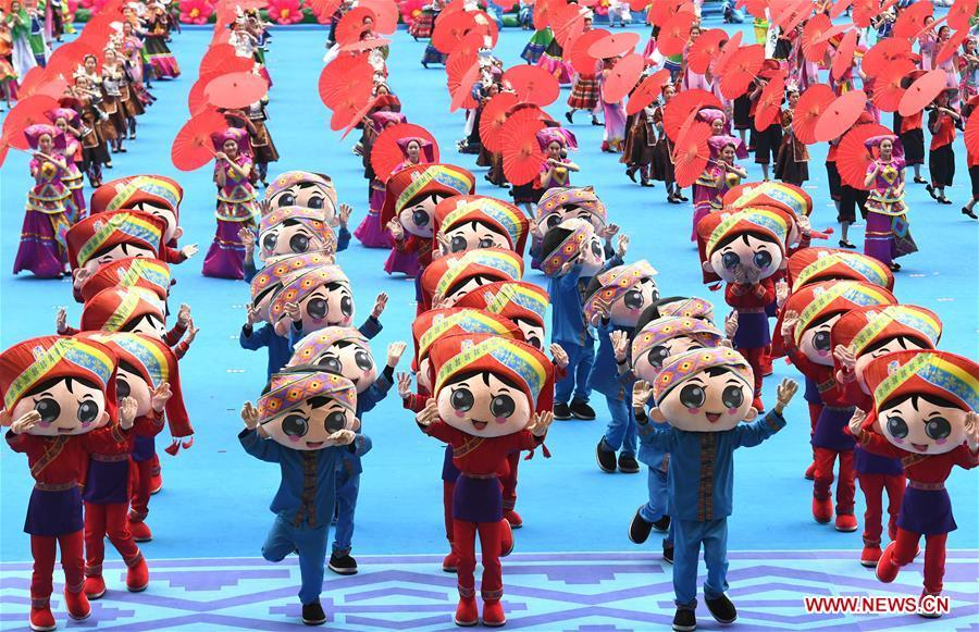 Dancers perform in a grand gathering held to celebrate the 60th anniversary of the founding of south China\'s Guangxi Zhuang Autonomous Region in Nanning, capital of Guangxi, Dec. 10, 2018. (Xinhua/Zhou Hua)