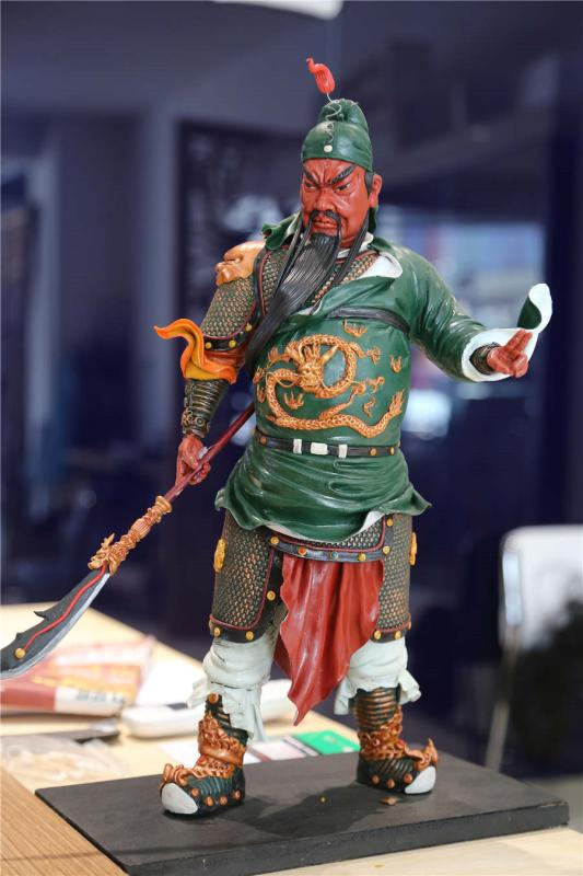 A dough figurine of Guan Yu, a character from Romance of the Three Kingdoms.  (Photo by Li Hao/for chinadaily.com.cn)