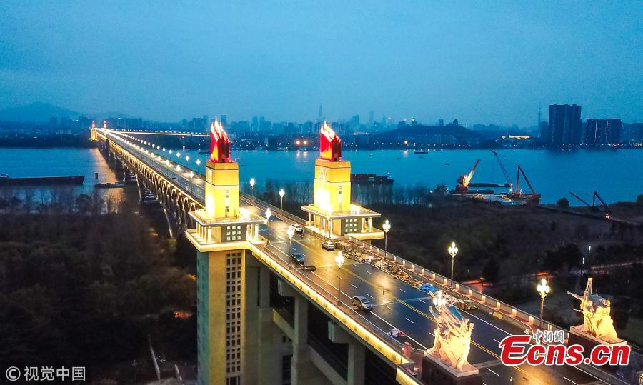 The lighting show at the Nanjing Yangtze River Bridge under renovation in Nanjing City, Jiangsu Province. Renovation of the landmark 50-year-old bridge, which was the first ever Chinese-designed bridge constructed across the Yangtze, is expected to be completed by the end of 2018. The new lighting system is more bright, intelligent and energy-saving, said local authorities. (Photo/VCG)