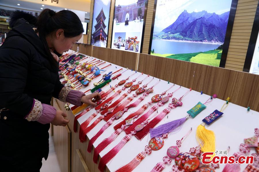 A woman selects ornaments with the elements of \