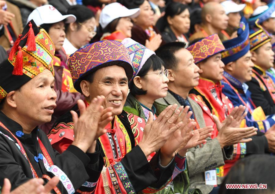 Spectators applause during a grand gathering held to celebrate the 60th anniversary of the founding of south China\'s Guangxi Zhuang Autonomous Region in Nanning, capital of Guangxi, Dec. 10, 2018. (Xinhua/Zhou Hua)