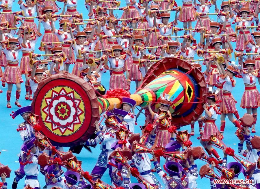 Dancers perform in a grand gathering held to celebrate the 60th anniversary of the founding of south China\'s Guangxi Zhuang Autonomous Region in Nanning, capital of Guangxi, Dec. 10, 2018. (Xinhua/Chen Jianli)