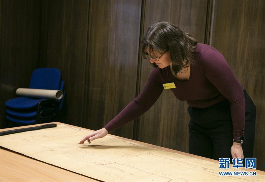 Archivist Rachel Gill shows the original designs for Chinese cruiser Zhiyuan at Tyne & Wear Archives in the city of Newcastle upon Tyne, England, Nov. 2, 2018. Zhiyuan, built and completed in England in 1887, was one of the most advanced warships in the Beiyang Fleet. It sank after the imperial Chinese navy was defeated in 1894 by the Japanese navy in the Battle of the Yellow Sea. The museum has a set of seven design drawings related to the Chinese cruiser. (Photo/Xinhua)
